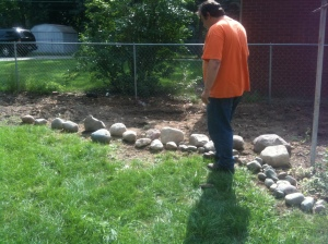 Matt surveys the new shipment of rocks. There's always room for more.