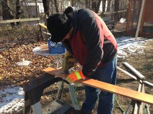 Matt trims a piece of wood using a jig saw.