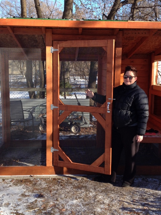 Jilli and the seriously awesome chicken coop door. It's rock 'n'roll, baby.