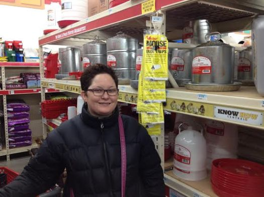 Jilli checks out the feed and water containers in the chicken section of TSC.