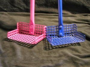 A blurry closeup of the Stand-n-Scoop.