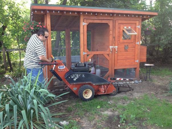Matt begins the trench in front of the chicken coop.