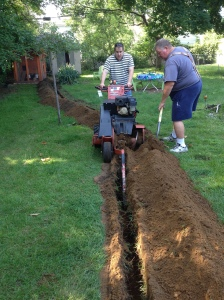 Matt and our neighbor To finish up the trench.